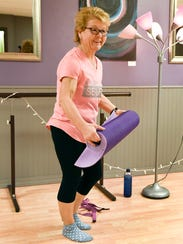 Tammy Habiger gets ready for a yoga class Wednesday,
