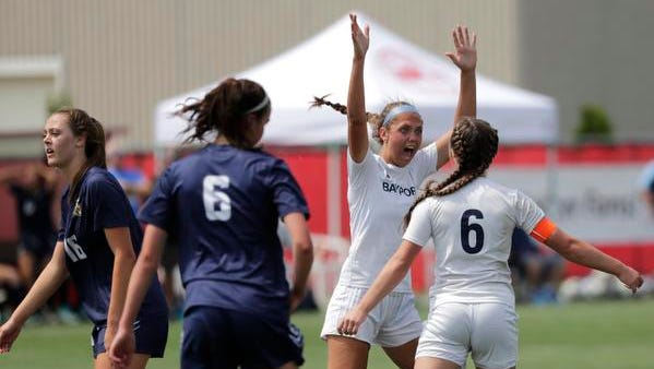 Bay Port's Emma Nagel (1) celebrates scoring a goal with teammate Erika Hess (6) during the WIAA Division 1 girls state soccer championship June 16. Nagel was named to the WSCA all-state first team while Hess earned honorable mention recognition.