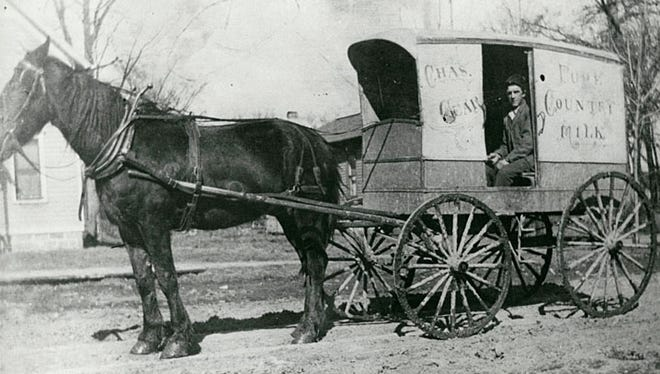 This is an undated photo of Charles Gear's milk wagon. He would fill pails that people brought to the wagon.