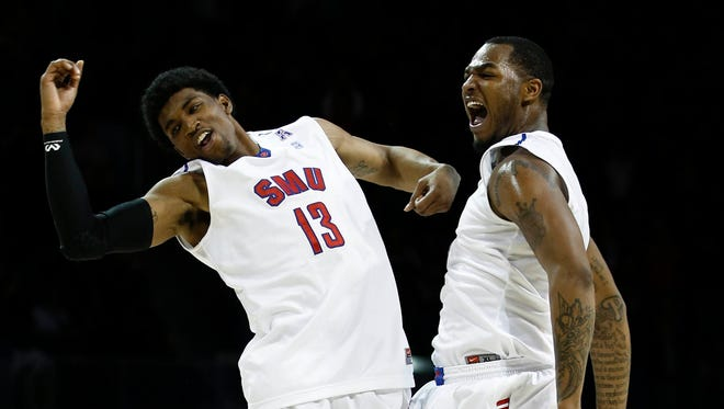 SMU guard Crandall Head (13) and forward Markus Kennedy (5) celebrate against Cincinnati during the second half of their big win Saturday at Moody Coliseum.