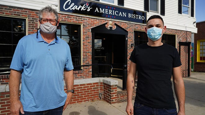 Doug Clark, left, and chef Dennis Margera are working to open Clark's American Bistro at the former location of Young's Restaurant on Main Street in Durham.