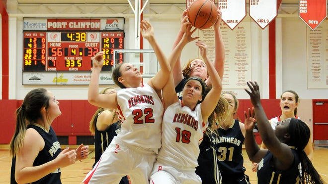 Port Clinton's Bethany Urban and Taylor Rollins reach for the ball during the Lady Redskins game versus SMCC at Port Clinton High School on Tuesday night. Port Clinton won, 63-39.
