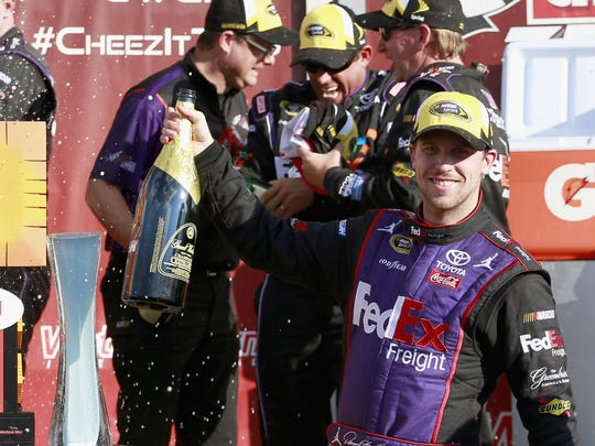 Denny Hamlin celebrates his win at Watkins Glen International last year.
