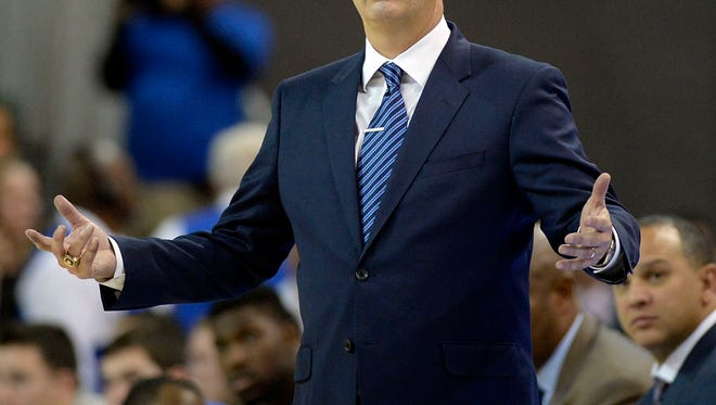 Kentucky Wildcats head coach John Calipari reacts during the second half against the UCLA Bruins at Pauley Pavilion.