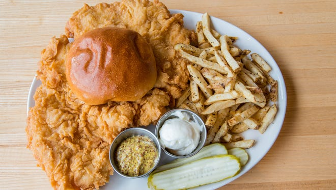 The breaded tenderloin is as big as its platter at Four Day Ray pub and brewery in Fishers.