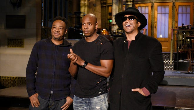 Dave Chappelle, center, with Jarobi White, left, and Q-Tip, right, of A Tribe Called Quest.