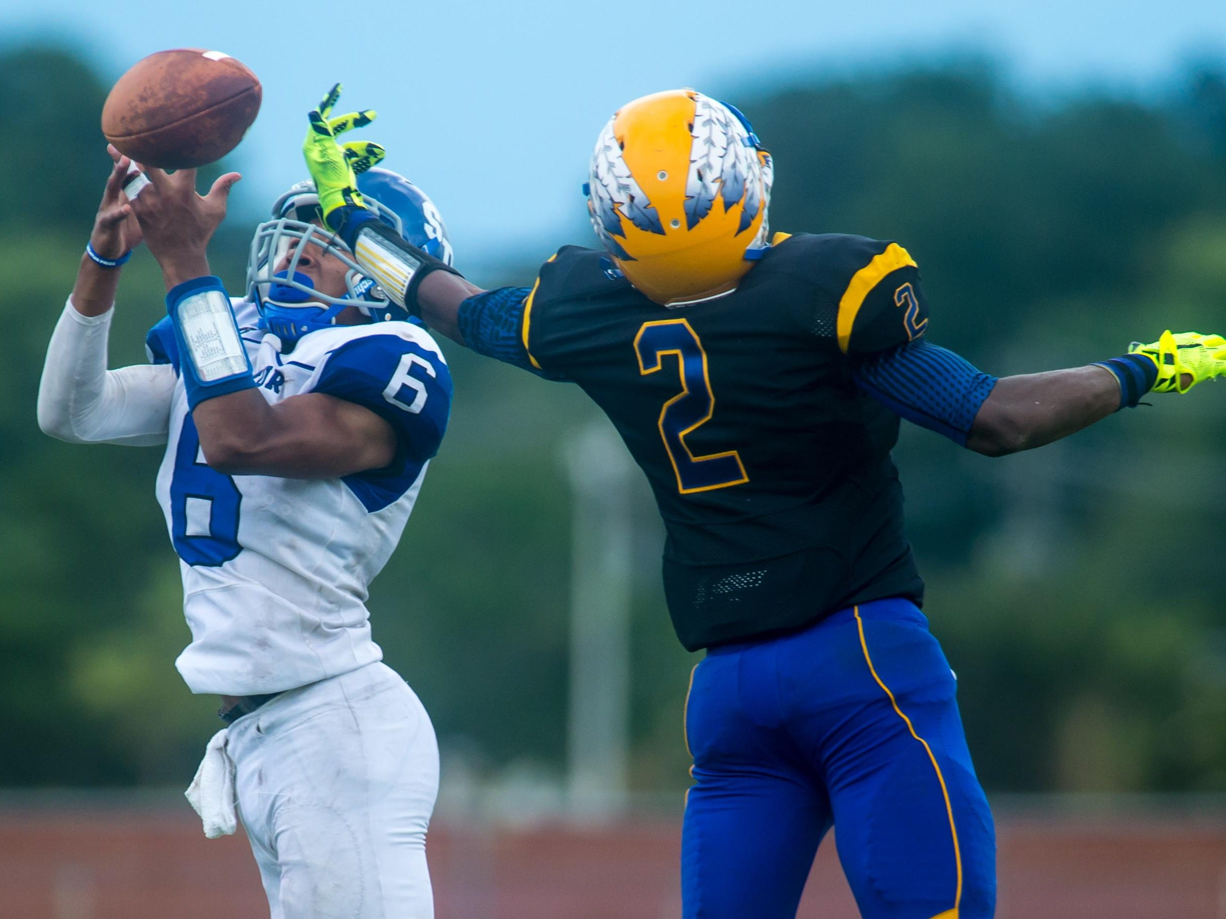 Stephen Decatur defensive back Darion McKenzie (6) attempts to pick off a Wicomico High pass intended for wide receiver Barry Gaines (2) on Saturday afternoon at Wicomico County Stadium.