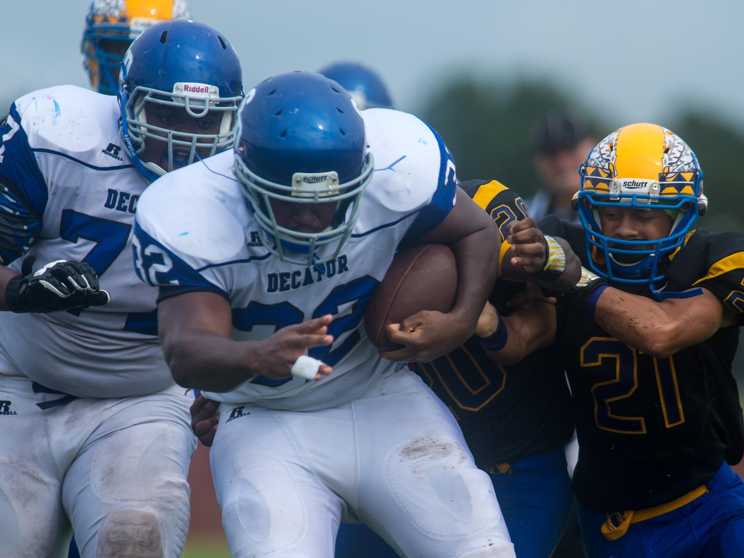 Stephen Decatur tight end De'Quan Andrews (32) rumbles for a huge third down gain against Wicomico High on Saturday afternoon at Wicomico County Stadium.
