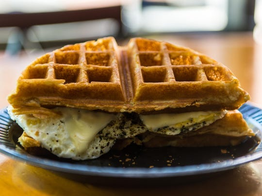 Breakfast Bum's Waffle Sandwich with egg, cheese and your choice of breakfast meat.