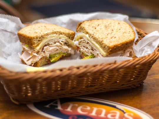 Arena's Cafe's California Club Dude is filled with turkey, avocado, Monterey jack cheese, sprouts, tomatoes and mayo.