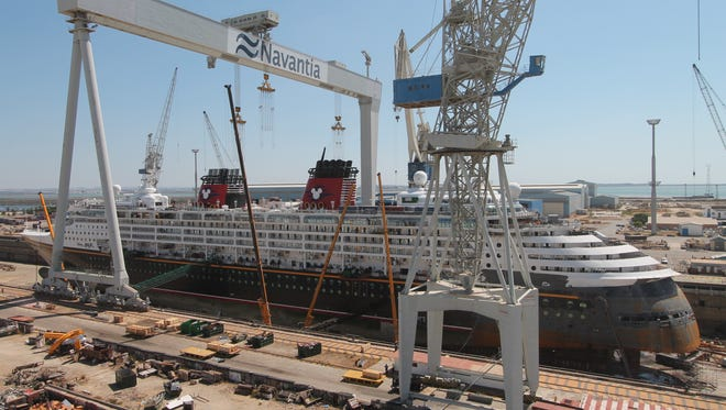 The 1,754-passenger Disney Magic undergoing a makeover at a shipyard in Cadiz, Spain in October 2013.