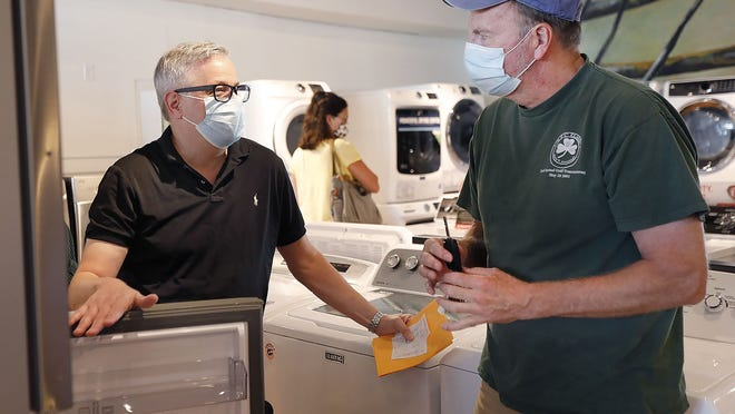 Hancock Appliance owner Bill Trifone talks with customer John Clough of Hyde Park about the purchase of the new refrigerator during the state's sales tax holiday weekend on Sunday, Aug. 30, 2020.   Greg Derr/The Patriot Ledger