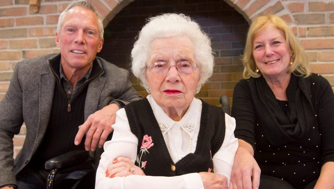 Clara Karr, photographed with two of her children, Peter Karr and Debbie Davis, will celebrate her 100th birthday Feb. 3.