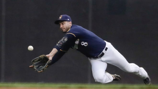 Milwaukee Brewers' Ryan Braun makes a diving catch on a ball hit by Anthony Rizzo.