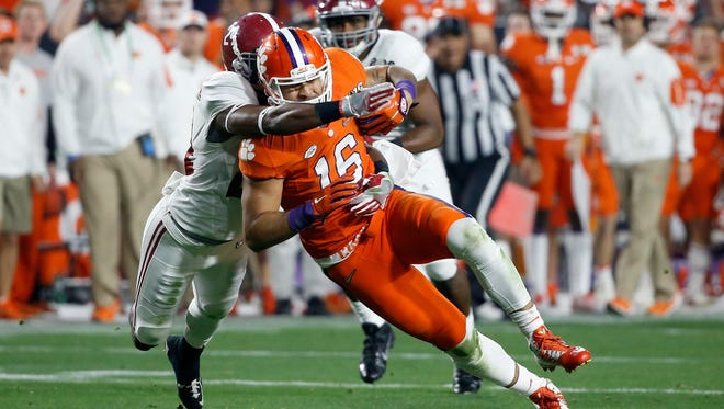 GLENDALE, AZ - JANUARY 11:  Jordan Leggett #16 of the Clemson Tigers runs after a catch as he is tackled by an Alabama Crimson Tide defender in the first half during the 2016 College Football Playoff National Championship Game at University of Phoenix Stadium on January 11, 2016 in Glendale, Arizona.  (Photo by Sean M. Haffey/Getty Images)