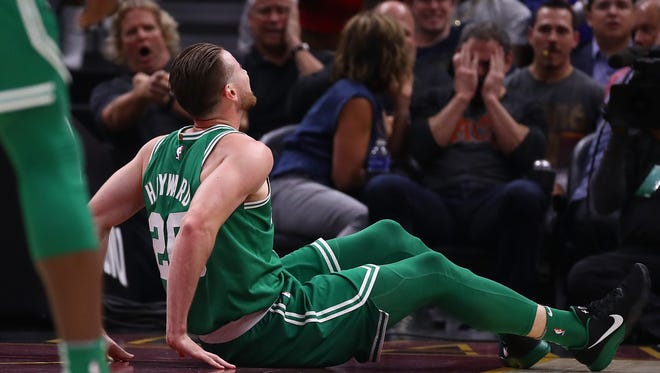 Gordon Hayward  of the Boston Celtics sits on the floor after being injured while playing the Cleveland Cavaliers at Quicken Loans Arena on October 17, 2017 in Cleveland, Ohio.