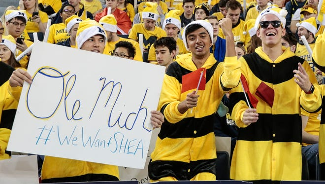 A Michigan fan holds a sign of #WeWantSHEA, referring to Ole Miss transfer QB Shea Patterson, before a basketball game against UCLA at Crisler Center in Ann Arbor, Saturday, Dec. 9, 2017.
