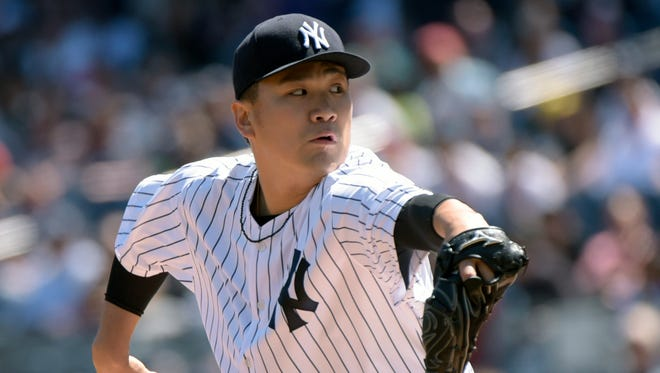 New York Yankees pitcher Masahiro Tanaka delivers to the Seattle Mariners during the first inning of a baseball game Sunday, April 17, 2016, at Yankee Stadium in New York.