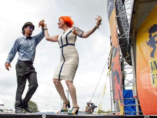 Meschiya Lake and the Little Big Horns perform on the Acura stage with Lake dancing with Chance Bushman at the New Orleans Jazz and Heritage Festival 2017 at the Fair Grounds in New Orleans, La., on Friday, April 28, 2017.