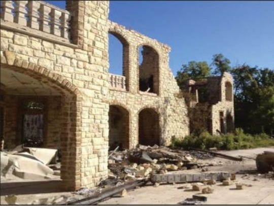Charred remains of Jeffrey and Maria Decker's mansion