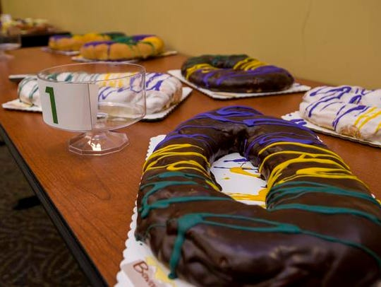A chocolate covered king cake with Bavarian creme filling