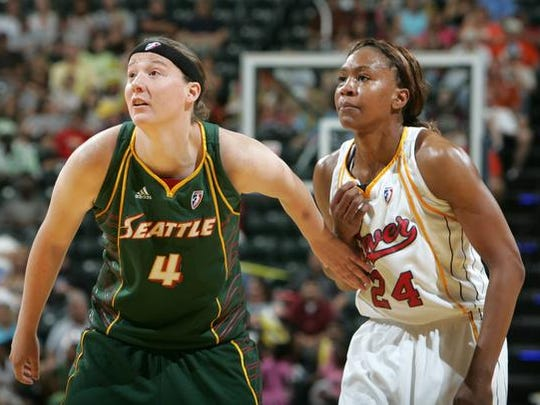 Seattle Storm Katie Gearlds guards Indiana Fever Tamika Catchings during their game at Conseco Fieldhouse in Indianapolis, Tuesday, June 9, 2009. (Heather Charles/The Star) <b>06/10/2009 - B01 - MAIN - 2ND - THE INDIANAPOLIS STAR</b><br />