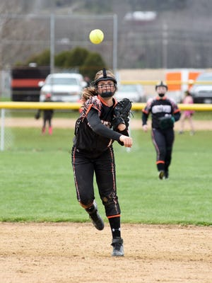 Ridgewood shortstop Abby Harding makes a throw to first base during the Generals' doubleheader against Coshocton on Saturday in West Lafayette. Coshocton won, 18-8, 11-6.