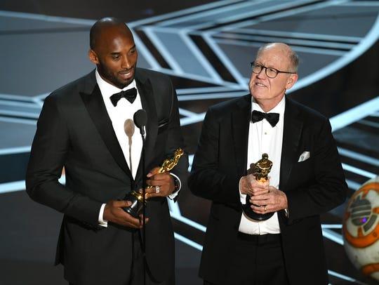 Kobe Bryant (left) and Glen Keane accept the Oscar