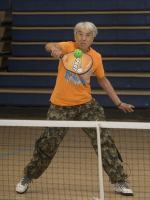 Ildi McElroy enjoys a game of pickleball at the Guy Thompson Community Center in Milton on Friday morning.