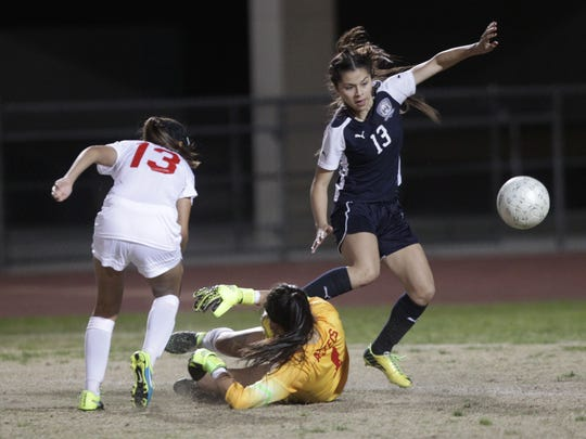 La Quinta High School's Jianna Guerrero controls the ball past the Palm Desert High School goalie for a goal to take the lead 3-1 in the second half of the game against Palm Desert High School at Palm Desert on February 11, 2016. La Quinta won the game 3-1 for the DVL title.