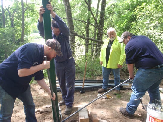 Employees from Nucor/Vulcraft in Chemung volunteered