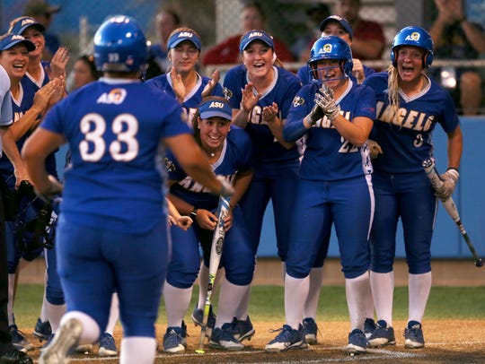 The Angelo State softball team gathers at home plate to celebrate after Alexis Evans hit a home run during the Rambelles' game against Texas Woman's at the 2017 Lone Star Conference Tournament on May 5, 2017.