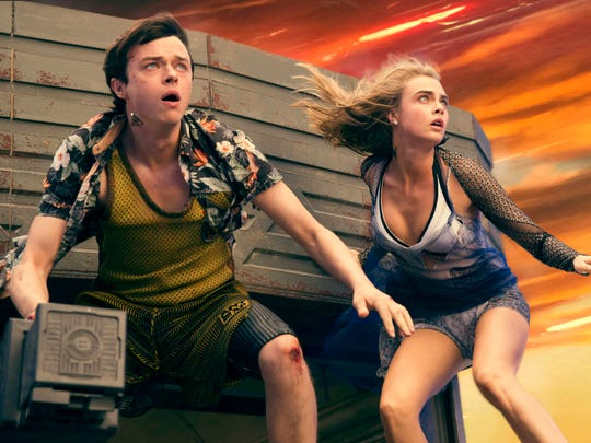 """Dane DeHaan and Cara Delevingne appear in a scene from """"Valerian and the City of a Thousand Planets."""""""