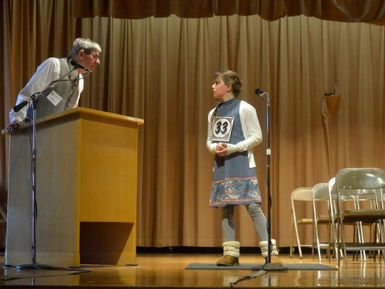 Lewis and Clark fifth-grader Grace Woldtvedt asks for a clarification from spelling bee pronouncer Tim Paul during the 2018 Cascade County Spelling Bee on Friday at West Elementary School.