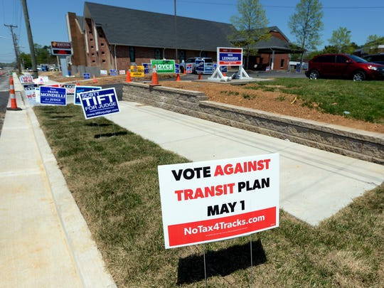 Several signs decorate the grass area in front of Joelton