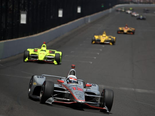 Will Power leads a pack of cars during the Indianapolis
