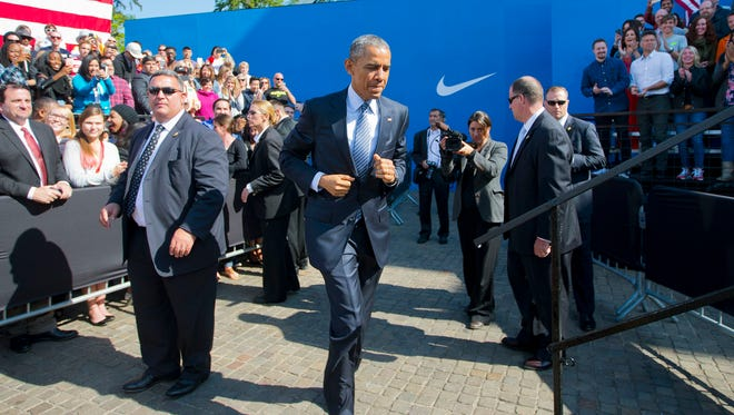 President Obama takes the stage before speaking at Nike headquarters in Beaverton, Ore. Friday. Obama visited the giant athletic apparel company to make his trade policy pitch as he struggles to win over Democrats for what could be the last major legislative push of his presidency.