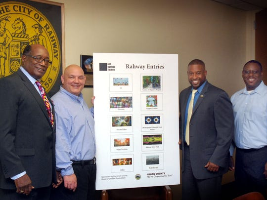 Left to right, Rahway Councilman David Brown, Rahway Mayor Samson Steinman, Union County Freeholder Chairman Mohamed S. Jalloh and Rahway Councilman Rodney Farrar show off the 'Art Outside the Box' artist submissions that will be featured on traffic control boxes at three Rahway intersections. Online voting will be available for residents to  pick the top three favorites. Learn more about the chairman's initiative at http://ucnj.org/artoutsidethebox/.