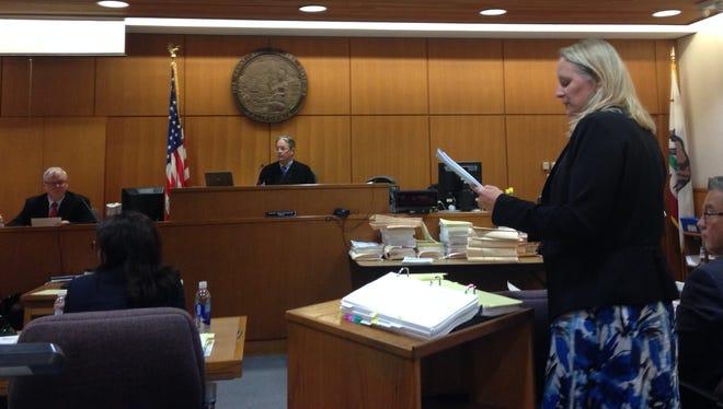 Defense attorney Lanetta Rinehart questions plaintiff's witness Dr. Matthew Keifer.