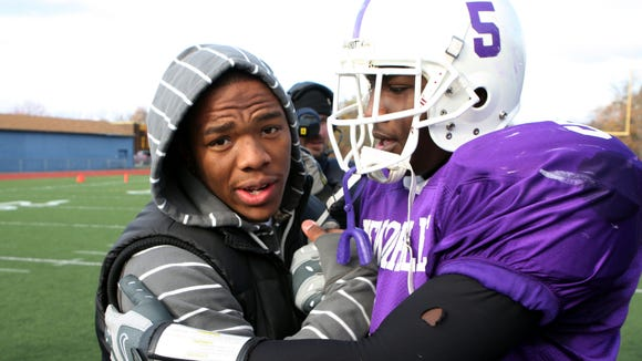 From left, Ray Rice hugs his brother, New Rochelle running back Markell Rice (5), after New Rochelle's 27-0 victory over North Rockland to win the Section 1 championship at Mahopac High School Nov. 10, 2007. Both Ray and Markell are former Super 11 picks. (Frank Becerra Jr./The Journal News)
