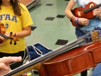 Beau Eerebout, 12 plays a violin during a strings camp at Thurman Francis Arts Academy, on Wednesday July 13, 2016.