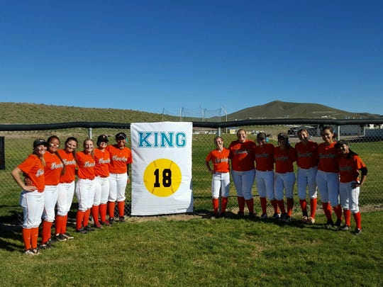 The Fernley High School softball team lines up to show off the banner commemorating the retirement of Jayme King's number before last Friday's softball game against Dayton.