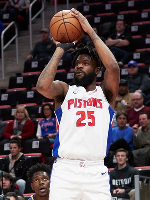 Feb 12, 2018; Detroit, MI, USA; Pistons swingman Reggie Bullock shoots in the first half against the Pelicans at Little Caesars Arena.