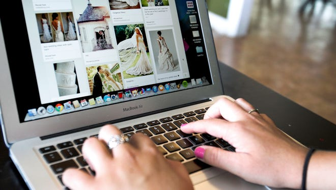 Katie Caito, 22, Indianapolis, goes through her Pinterest boards at home. She isn't married or engaged, but she keeps a Pinterest board of wedding and reception ideas and goals.