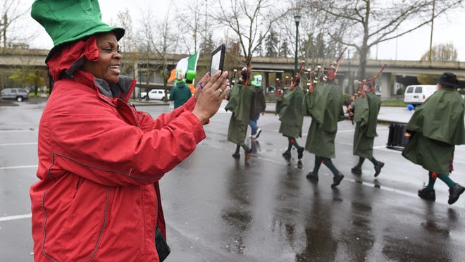 Clara Harris uses an iPad to shoot video of the annual Céilí of the Valley St. Patrick's Day Parade on Saturday, March 14, 2015, in downtown Salem.
