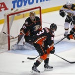 Anaheim Ducks defenseman Simon Despres, right, clears