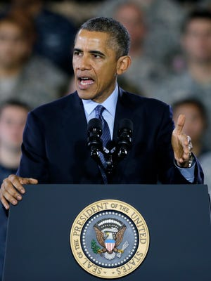President Barack Obama addresses a gathering of military members and families on Dec.15 at Joint Base McGuire-Dix-Lakehurst in Wrightstown.