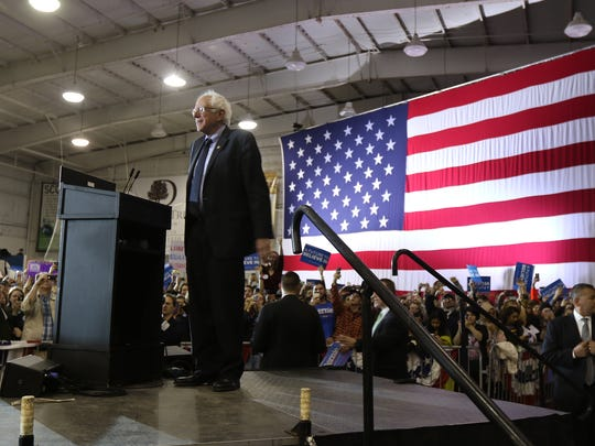 Bernie Sanders takes in the crowd at a presidential
