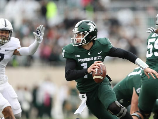 Michigan State's Brian Lewerke looks to pass against