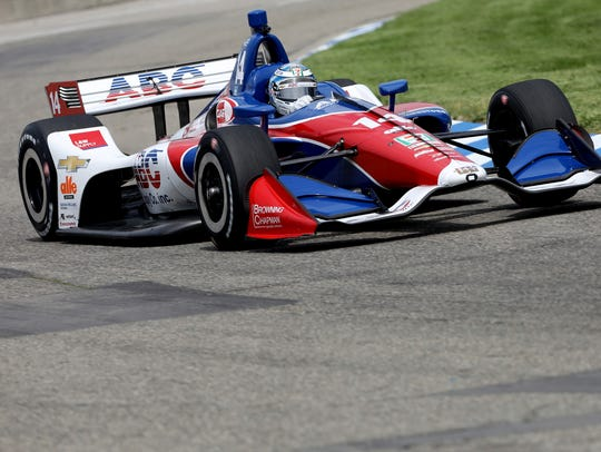 Tony Kanaan of AJ Foyt Enterprises heads around turn two during practice on Belle Isle on Friday.